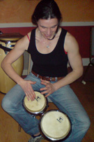 learning to play Martillo on bongo