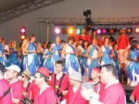 stage performance with singers, dancers & drummers